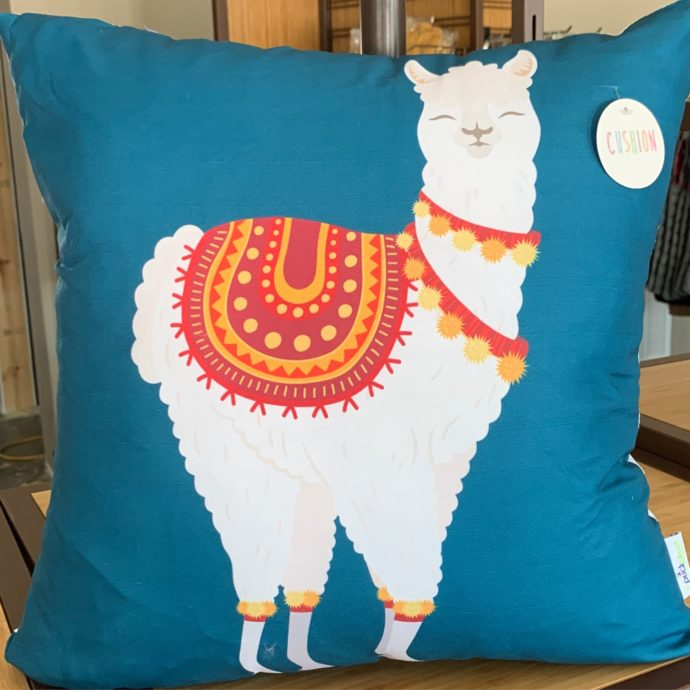 Alpaca Pillow With Blue Background